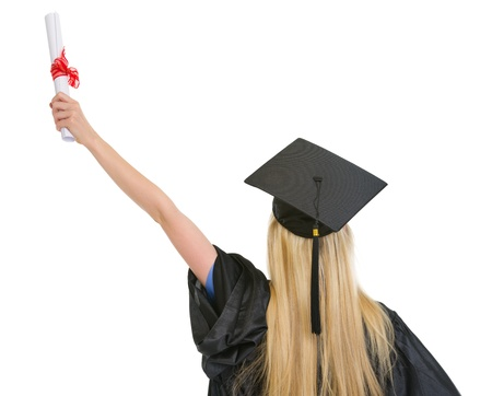Woman in graduation gown with diploma rejoicing success . rear view photo