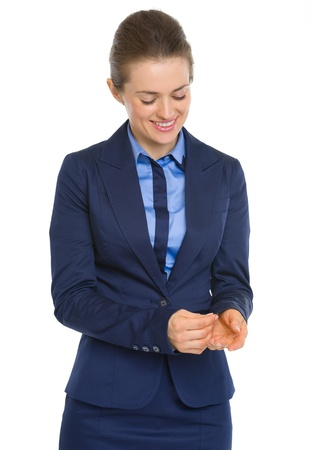 Happy business woman adjusting cuff Stock Photo - 19614329