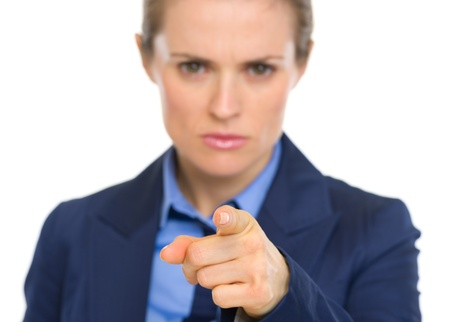 disquieted: Closeup on concerned business woman pointing in camera