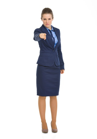 authoritative woman: Full length portrait of serious business woman pointing in camera