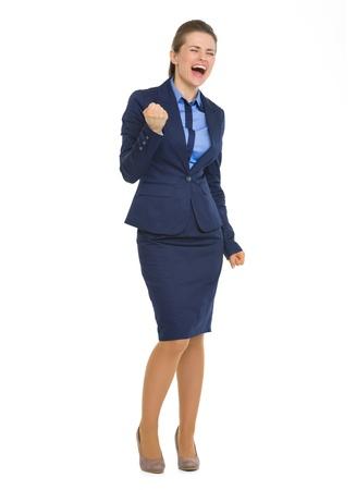fist pump: Full length portrait of happy business woman making fist pump gesture