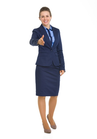 Full length portrait of happy business woman stretching hand for handshake Stock Photo - 19614205