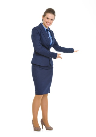 Full length portrait of happy business woman inviting