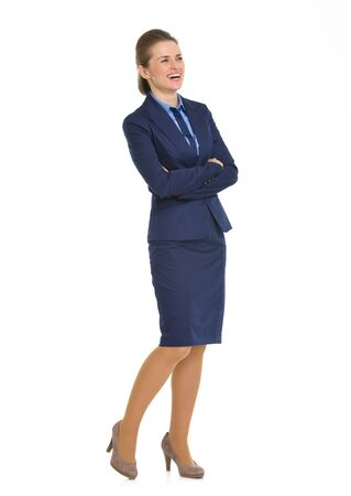 Full length portrait of smiling business woman looking on copy space photo