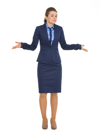 shrugging: Portrait of clueless business woman shrugging shoulders Stock Photo