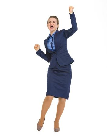 rejoicing: Full length portrait of happy business woman rejoicing success