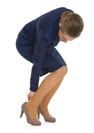 Business woman experiencing pain from shoes photo