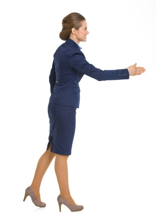 Full length portrait of happy business woman stretching hand for handshake Stock Photo - 19614200
