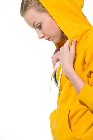 Modern teenager girl in sweater with draped hood looking on copy space photo