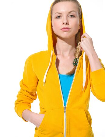 youthfulness: Portrait of serious teenager girl in sweater with draped hood