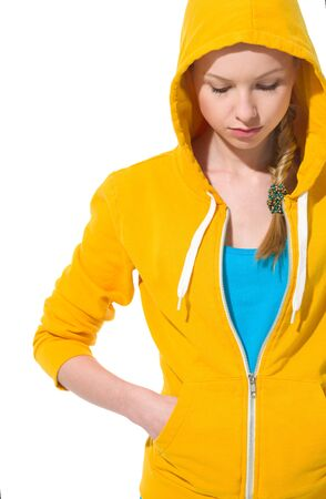 Closeup on modern teenager girl in sweater with draped hood photo