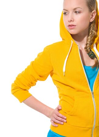 pert: Modern teenager girl in sweater with draped hood looking on copy space