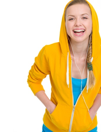 Happy teenager girl listening music in earphones Stock Photo - 19614299