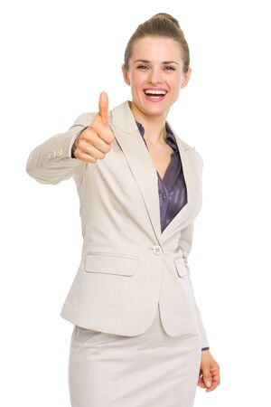 Happy business woman showing thumbs up photo