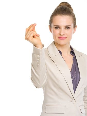 Confident business woman snapping fingers photo