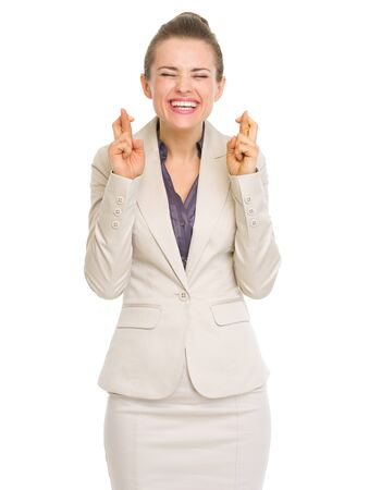 crossed fingers: Happy business woman with crossed fingers Stock Photo