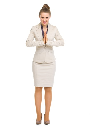civility: Full length portrait of business woman showing asian greeting