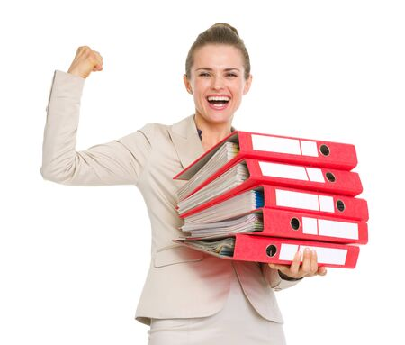 surety: Smiling business woman holding stack of folders and showing biceps