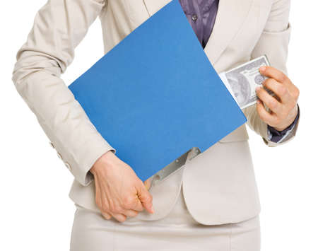Closeup on business woman hiding pack of dollars in folder Stock Photo - 19727817