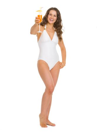 Full length portrait of happy happy young woman in swimsuit with cocktail photo