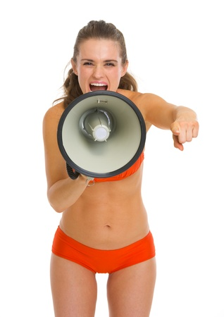 Angry young woman in swimsuit shouting through megaphone and pointing in camera Stock Photo - 19727641