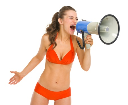 Angry young woman in swimsuit shouting through megaphone Stock Photo - 19727623