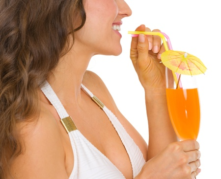Closeup on young woman in swimsuit drinking cocktail Stock Photo - 19848798