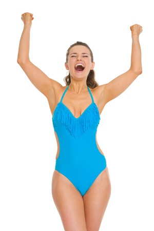 Happy young woman in swimsuit and hat rejoicing success Stock Photo - 19810179