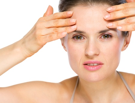 Beauty portrait of concerned young woman checking facial skin Stock Photo - 19848818