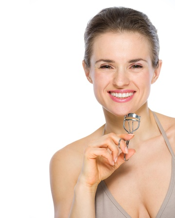 Beauty portrait of smiling young woman holding eyelash curler Stock Photo - 19848791
