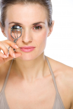 Beauty portrait of young woman using eyelash curler Stock Photo - 19848835