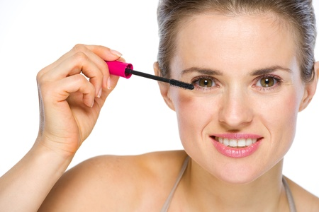 Beauty portrait of happy young woman applying mascara Stock Photo - 19848804