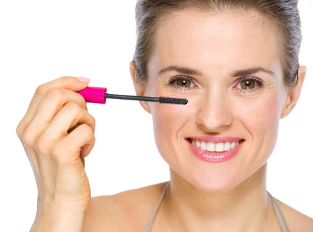Beauty portrait of happy young woman applying mascara Stock Photo - 19848802
