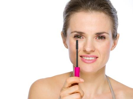 Beauty portrait of young woman holding mascara brush Stock Photo - 19848742