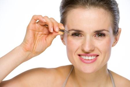 Beauty portrait of happy young woman using tweezers Stock Photo - 19848839