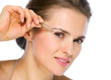 Beauty portrait of young woman using tweezers Stock Photo - 19848800