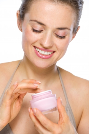 Beauty portrait of happy young woman with creme Stock Photo - 19848838