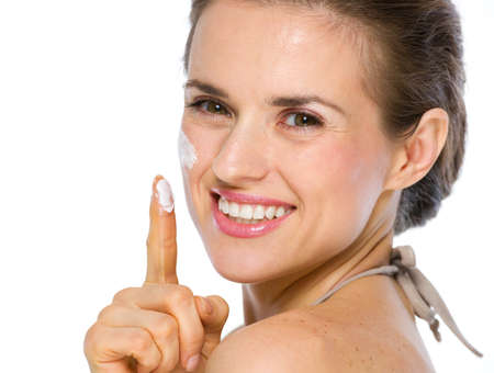 Beauty portrait of happy young woman showing creme on finger Stock Photo - 19848797