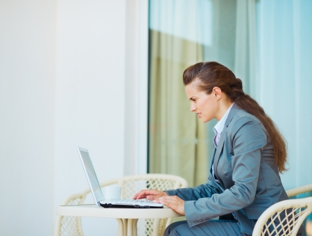 topicality: Business woman working laptop on terrace