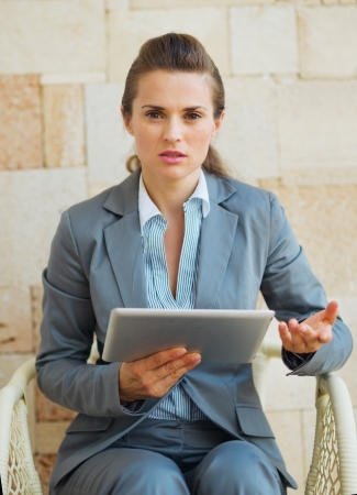 Concerned business woman working with tablet pc on terrace Stock Photo - 20310032