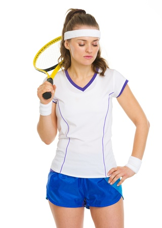 girl in sportswear: Portrait of thoughtful tennis player with racket