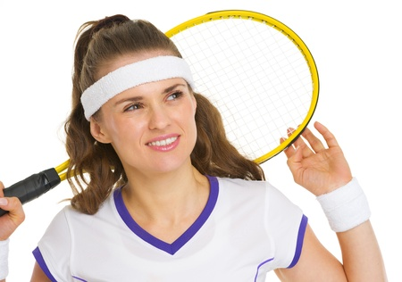 Dreamy tennis player with racket photo