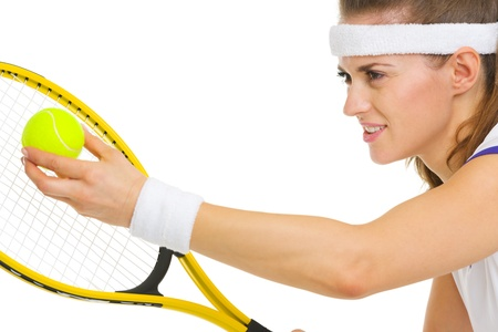 Closeup on female tennis player serving ball photo