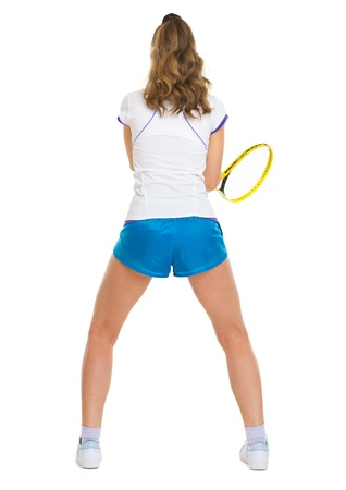 Female tennis player in stance . rear view photo