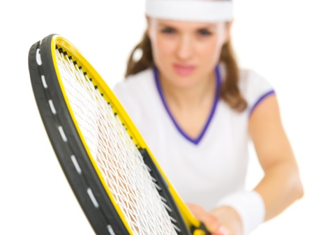Closeup on racket in hand of tennis player in stance photo