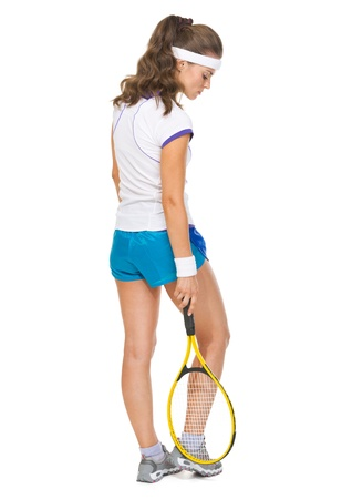 Full length portrait of serious female tennis player photo