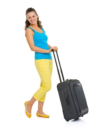 Full length portrait of happy young tourist woman with wheel bag Stock Photo - 20356461