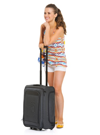 Happy young tourist woman with wheel bag looking on copy space Stock Photo - 20351000