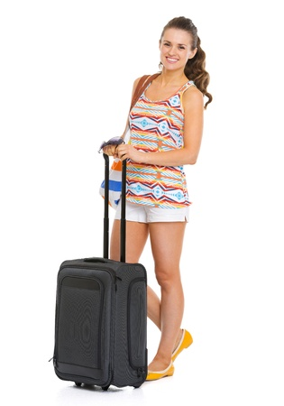 Full length portrait of smiling young tourist woman with wheel bag Stock Photo - 20351029