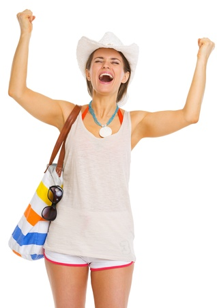 rejoicing: Happy young woman with beach bag rejoicing success Stock Photo